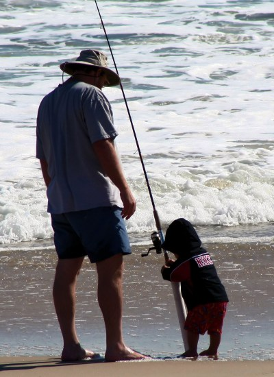 father fishing